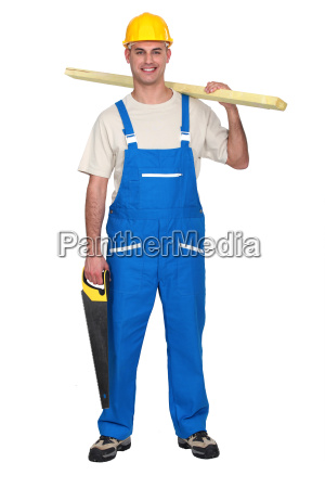 carpenter carrying a saw and a
