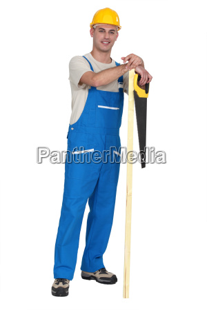 carpenter with plank of wood and