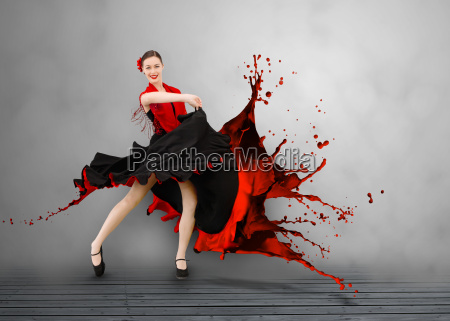 flamenco dancer with dress turning to