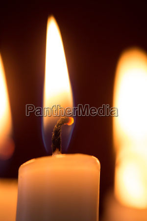 close up of lit candle on
