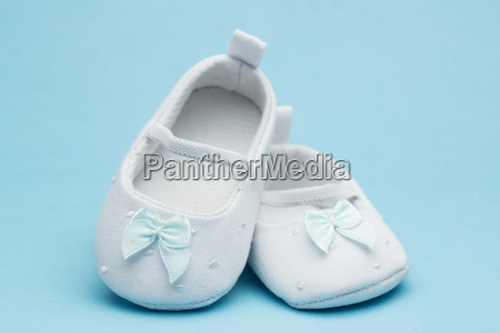 baby booties with blue ribbon on