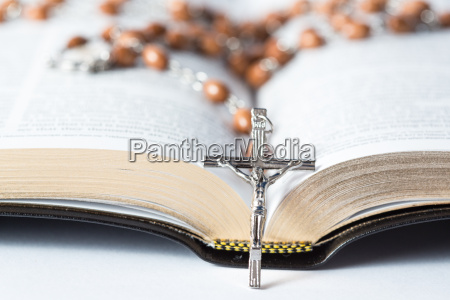 cross of rosary beads resting against