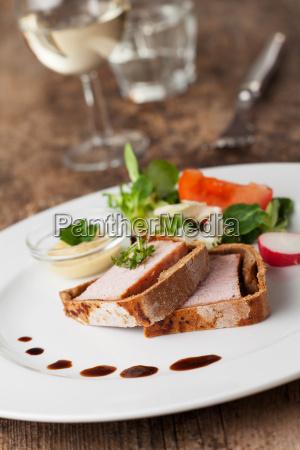 slices of ham in bread dough