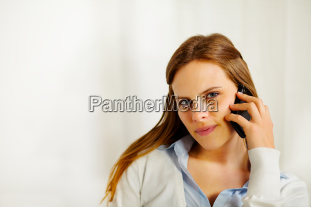 beautiful businesswoman talking on the mobile