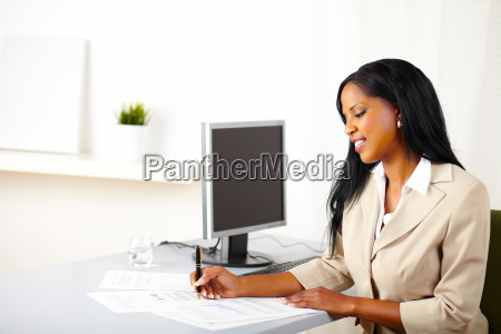 young business female working on documents