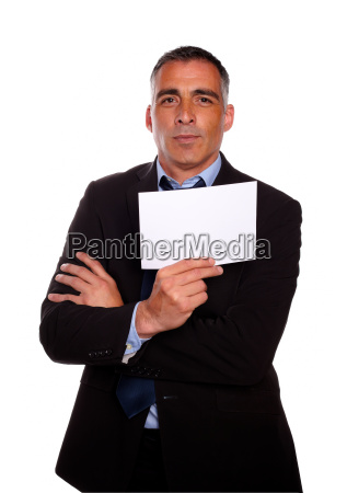 mature business man holding a white