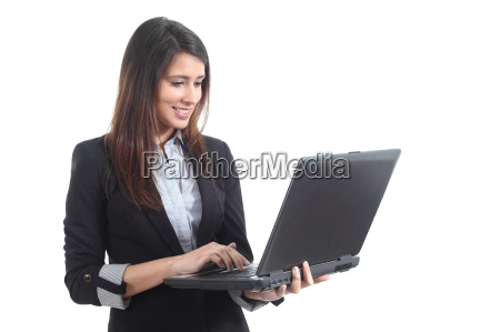 beautiful businesswoman standing typing on a