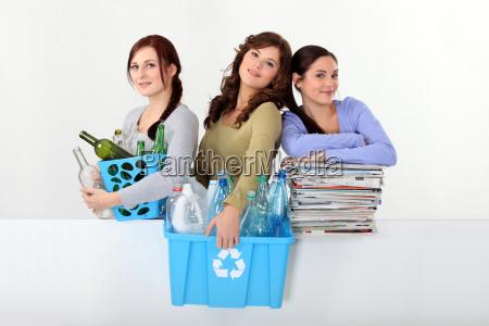 young women recycling