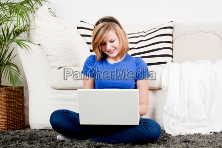tennager girl laughing at computer
