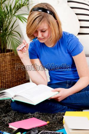 young teenage girl doing homework