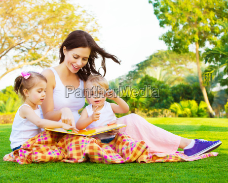 woman with daughter and son read