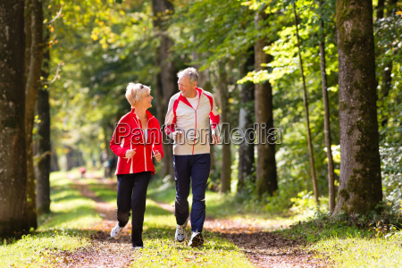seniors jogging in the forest