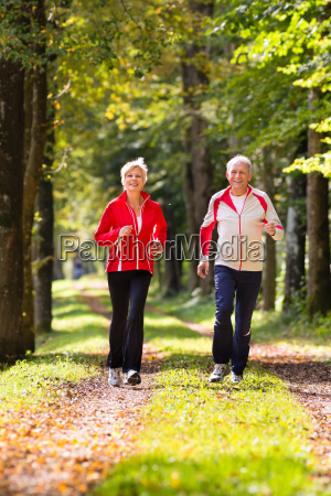 seniors jogging in forest