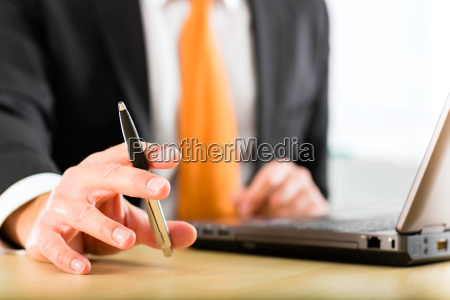 businessman with laptop in his office