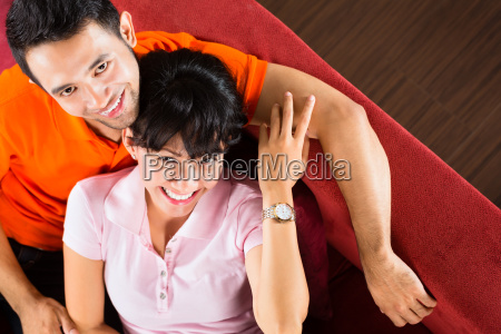 asian couple at home on the