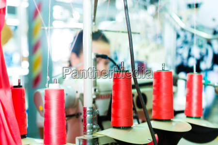 spools of thread in a textile