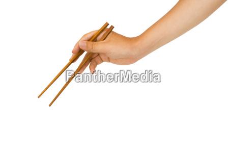 hand holding chopstick