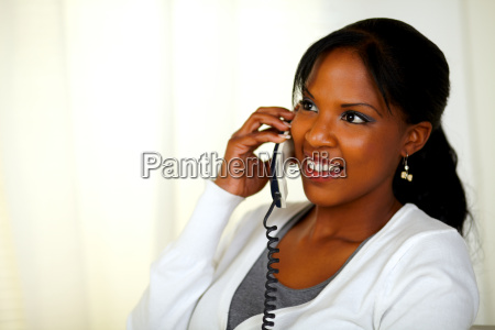 charming relaxed woman speaking on phone