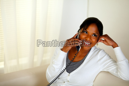 relaxed woman smiling and conversing on