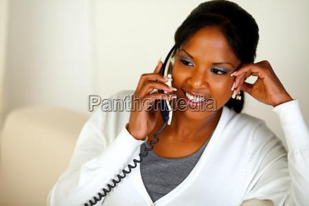 afro american female conversing on phone