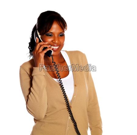 adult woman speaking on phone