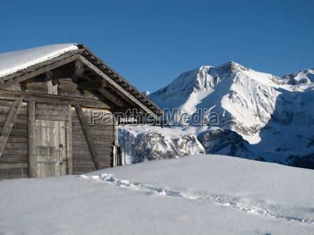 hut and mountain in the bernese