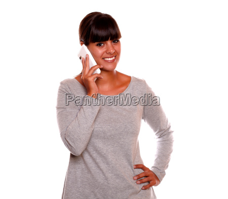 attractive young woman speaking on cellphone