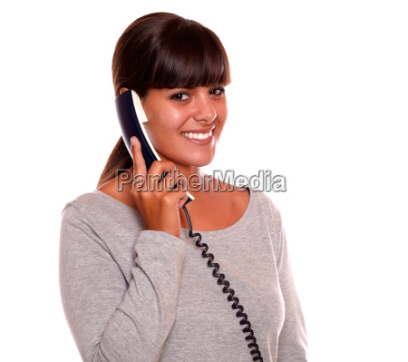 beautiful young female speaking on phone