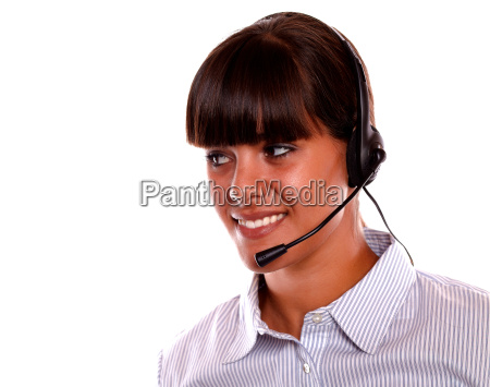 smiling young woman using earphone looking
