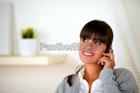 young woman speaking on cellphone looking