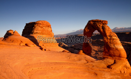panorama of delicate arch at sunset