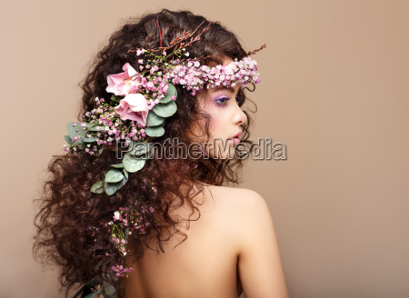 profile of woman with colorful wreath