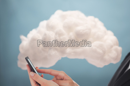 businesswoman connecting phone to cloud computing