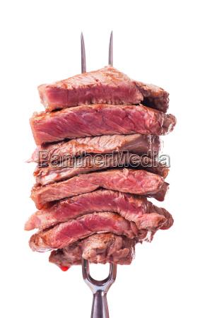 steak sliced on a meat fork