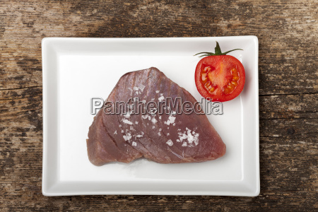 raw tuna steak on a plate
