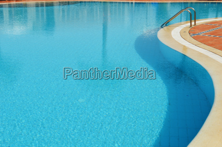 swimming pool in touristic resort during