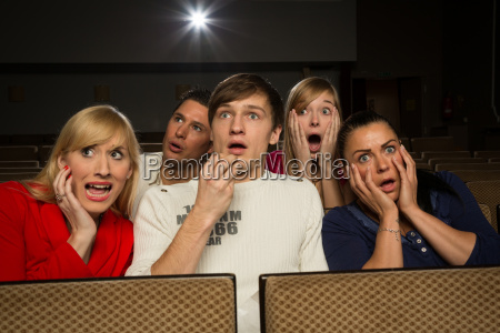 sitting frightened people sitting in the