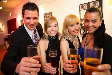 friends celebrate together in a pub