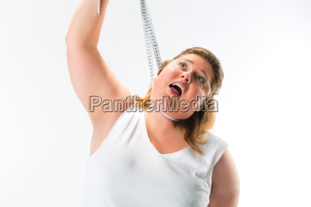 fat woman choking herself with measuring