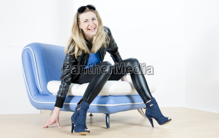 woman wearing fashionable shoes sitting on