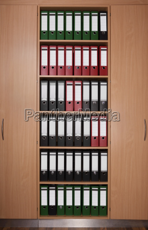 office cabinet with file folders wooden