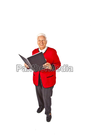 smiling attractive elderly woman reading in