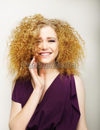 pleasure happy face of frizzy redhead