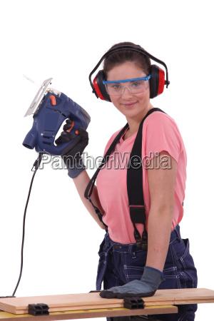 woman using an electric saw