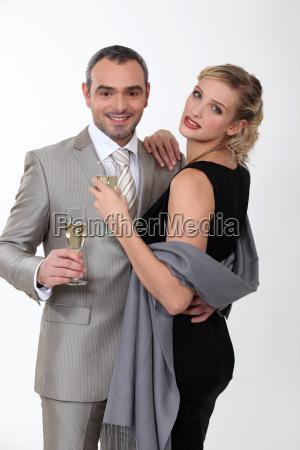 elegant couple celebrating with champagne on