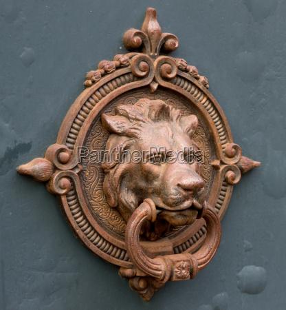 ancient iron doorknockerlions head