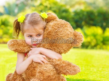 sad girl with teddy bear