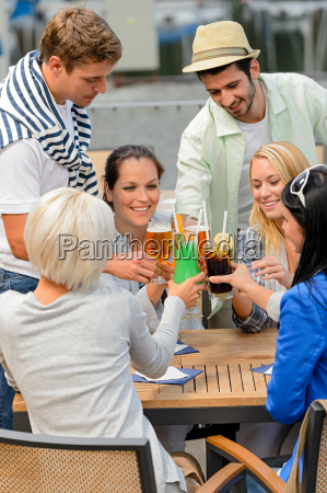 group of cheerful people toasting with