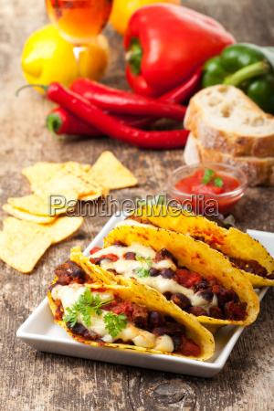 give taco with chili con carne