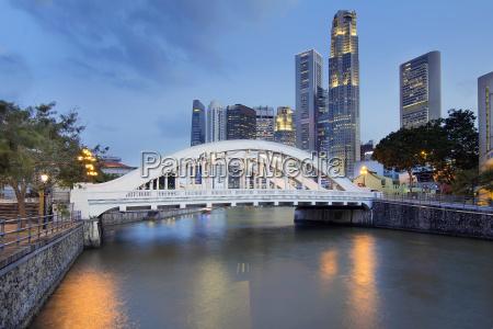 singapore skyline by elgin bridge along